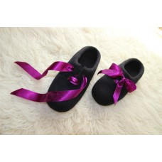Black slippers with elegant violet ribbon